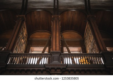 Ireland, Dublin - 19. 09. 2018. Interior shot of Trinity college library with long wall of books and bust indoors