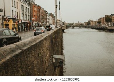 Ireland, Dublin - 19. 09. 2018. Perspective view of city channel with stone embankment and aged buildings in gray day