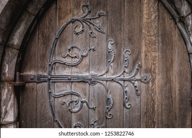 Ireland, Dublin - 20. 09. 2018. Exterior of aged wooden doorway with ornamental iron rivet in medieval section of city