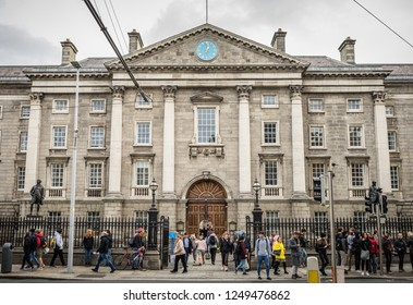 Ireland, Dublin - 29. 09. 2018. Exterior view of old Trinity college facade with columns and people on sidewalk in front