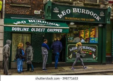 IRELAND, DUBLIN - APRIL 3, 2015: People waiting in line to order food. Traditional fish & chips in Dublin