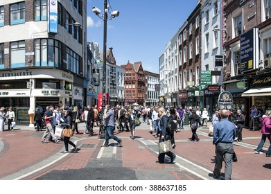 Ireland, Dublin: Street scene - people citizens tourists students of all ages in the busy shopping promenade Grafton Street of Ireland's capital. June 09, 2015