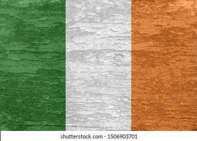 Ireland flag on an old painted wooden surface. Textured wallpaper background for design.