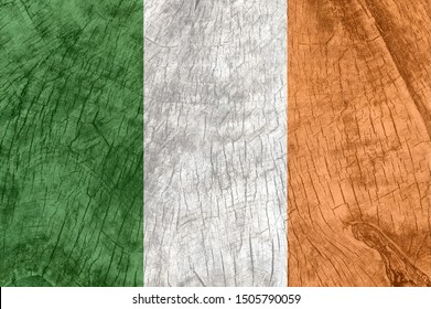 Ireland flag on an old wooden surface. Textured wallpaper background for design.