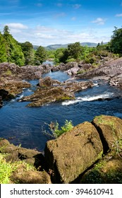 Ireland, near Ring of Kerry: Landscape scenery with blue water rapids which streams through rocks, horizon and blue sky in the background - concept nature water beauty adventure health hiking