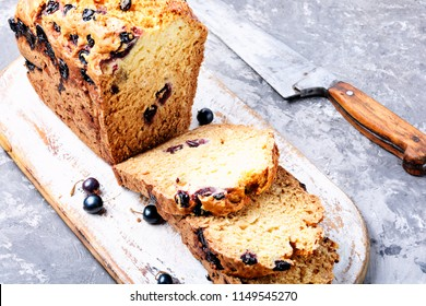 Ireland soda bread with black currant berries.Fresh bread slice and cutting knife
