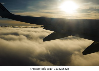 Ireland to Tenerife, Europe  - 23 December, 2017. The wing tip of a Ryanair Boeing aeroplane during flight above clouds .
