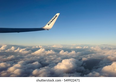Ireland to Tenerife, Europe  - December 23, 2016 - The wing tip of a Ryanair Boeing 737 aeroplane during flight above clouds