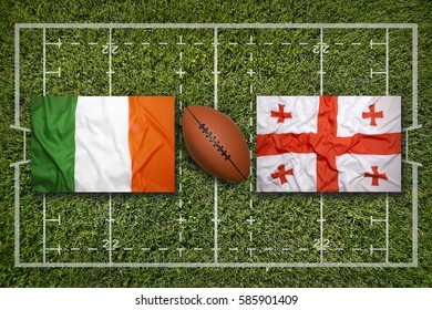 Ireland vs. Georgia flags on green rugby field