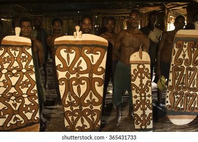 Irian Jaya, Indonesia, 9 September 2011. Asmat woodcarvers showing their traditional shields made of tree bark in Omandeseb Village.