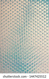 Iridescent holographic mermaid fish scales faux leather texture background.