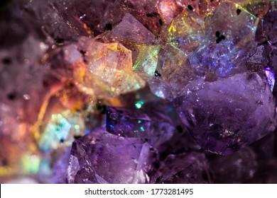 Iridescent natural transparent glossy and magic geometric Quartz crystal structure through sun light. Texture of gemstone with rainbow effect. Luster closeup. Geology of beauty.