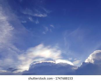 Iridescent pileus cloud or rainbow cloud