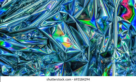 Iridescent shimmering Holographic color wrinkled foil. Real Hologram Background of wrinkled abstract foil texture with multiple colors. holographics gradient mesh background or surface.