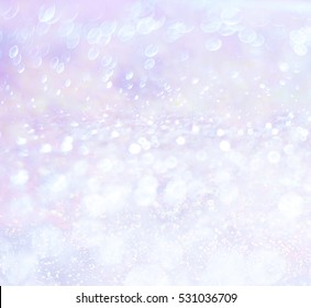 The iridescent, sparkling background