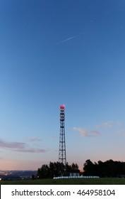 Iridium satellite flare above a mobile phone pylon.