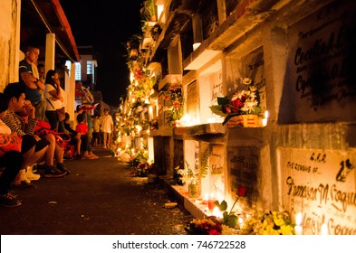 Iriga City, Philippines - November 1, 2017: People celebrating all-saint's day in the public cemetery