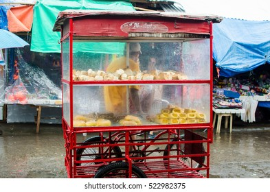 Iriga City, Philippines - November 2016: Bread guy selling on a three wheeled red bike for a mobile selling