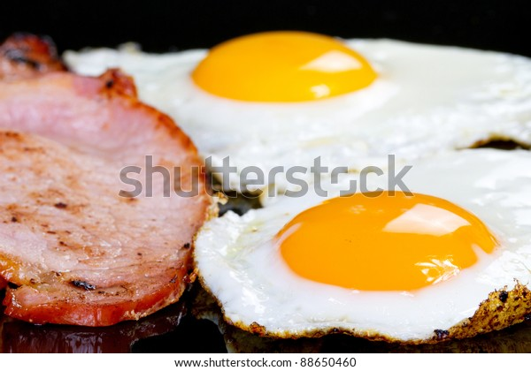 Irish breakfast with two eggs, bacon and toast