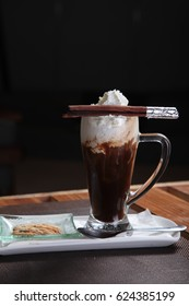 Irish coffee drink with cinnamon stick