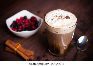 Irish coffee in simple glass with fruits