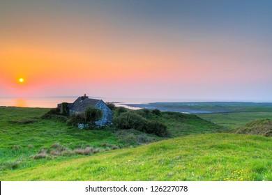 Irish cottage house at sunset