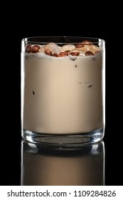Irish cream cocktail in Rocks glass isolated on black
