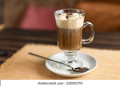 Irish cream coffee decorated with coffee beans on the table