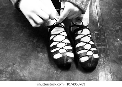 Irish Dance Girl Tying Ghillies Soft Shoes