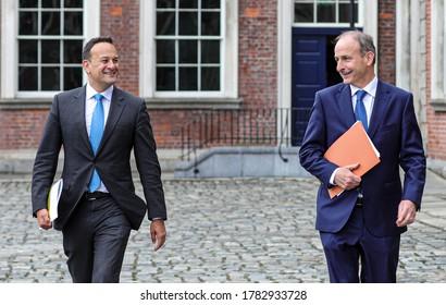 Irish deputy Prime Minister Leo Varadkar (left) and Prime Minster Micheál Martin (right) walk across the courtyard at Dublin castle in Ireland, following an Irish government meeting, July 23, 2020