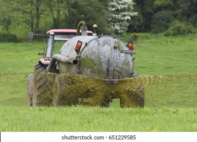 Irish farmer spreading slurry in field