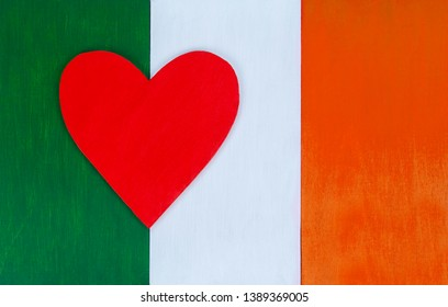 Irish flag and heart, love for Irish culture - nation of Ireland - painted wooden background for rustic, pastel, vintage and authentic styles.