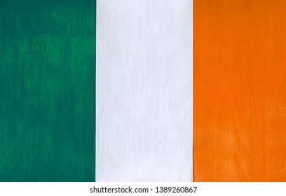 Irish flag as a painted wooden background, for rustic, vintage and authentic styles - pastel paint on wood for the country of Ireland.