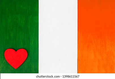 Irish flag as a painted wooden background, for rustic, vintage and authentic styles - pastel paint on wood, with heart, for love of the country of Ireland.