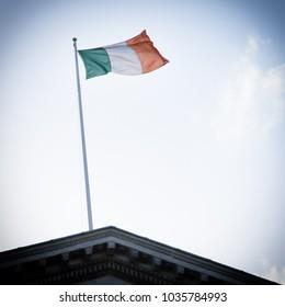 Irish flag waving on top of Dublin's city hall.