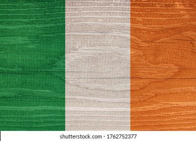 Irish flag with wood texture. Flag of Ireland on wood texture