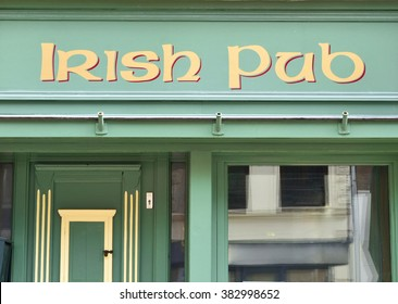 Irish pub, frontal view to the old facade of an antique pub.