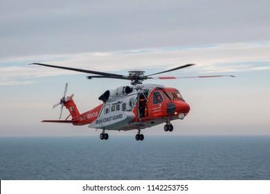 IRISH SEA, IRELAND: 15 July 2018 - Irish Coast Guard Helicopter Hovering Over Sea