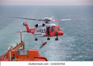 IRISH SEA, IRELAND: 15 July 2018 - Irish Coast Guard Helicopter Practice Rescue Mission on Stena Ferry