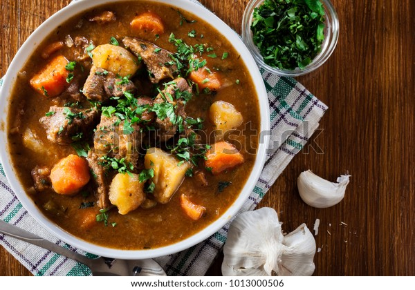 Irish stew made with beef, potatoes, carrots and herbs. Traditional  St patrick's day dish. Top view
