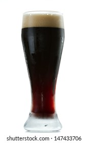 irish stout isolated on a white background served in a cold glas