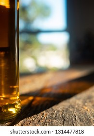 Irish Whiskey Bottle Close Up with Sun and Shadows