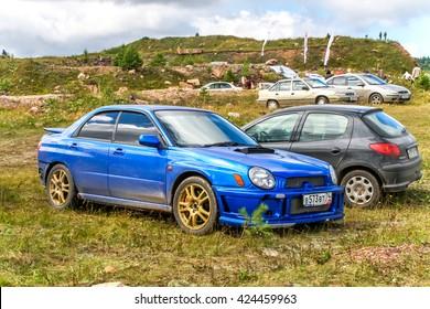 IRKUSKAN, RUSSIA - AUGUST 08, 2008: Motor car Subaru Impreza at the countryside.