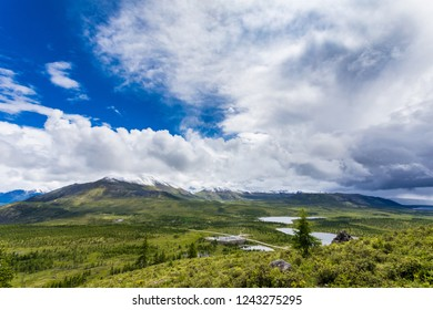 Irkut river valley, mountains, clouds, summer, snowy peaks