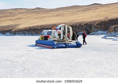 Irkutsk, Russia: April 08, 2018: Russain hovercraft for crossing Baikal lake park on the ice water at the pier in winter