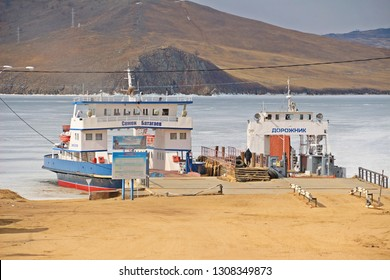 Irkutsk, Russia: April 10, 2018: Two Russainboats for crossing Baikal lake cannot move and park on the ice water at the pier in winter
