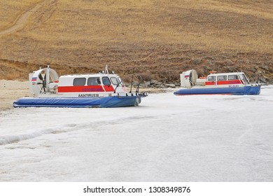 Irkutsk, Russia: April 10, 2018: Two Russain hovercrafts for crossing Baikal lake park on the ice water at the pier in winter
