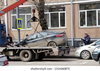 Irkutsk, Russia: April 12, 2018. The poiceman arrested people who park at no parking area and carrying the car out of the place.
