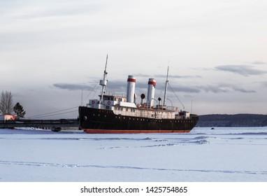"IRKUTSK, RUSSIA - MARCH 20, 2019: Steamer-icebreaker ""Angara"" pre-revolutionary buildings, One of the oldest surviving icebreakers in the world. Irkutsk, Russia"
