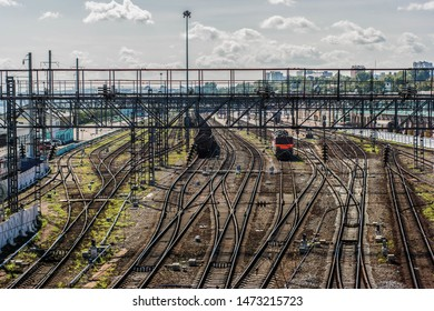 Irkutsk train station with train and coal wagon, Siberian trainstation